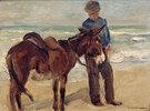 Junge mit Reitesel am Strand
