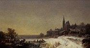 Winterliches Dorf mit Kirche an einem See