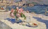 Blumenstrauss und Früchteteller am Meeresstrand