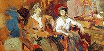 Zwei Damen in Korbstühlen