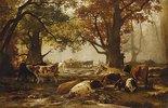 Kuhherde unter Herbstbäumen