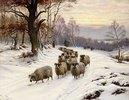 Ein Schäfer mit seiner Herde auf einem Weg im Winter