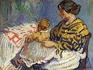 Frau B. mit ihrem Baby auf dem Schoß
