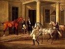 Dem Schloßherrn werden zwei edle Pferde vorgeführt