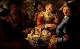 Junges Bauernpaar mit Musikanten