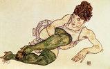 Liegende Frau mit grünen Strümpfen. D1995. Gouache and black crayon. 1917. 29,4 x 46 cm