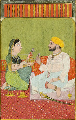 Indien: Ein sitzendes Paar, Blumen haltend.