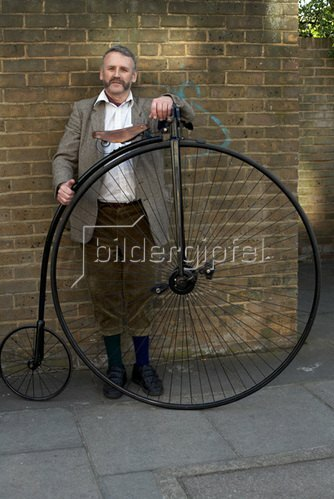 Horst A. Friedrichs: Cycle Style.<p>Gentleman with his High Wheel Bicycle.