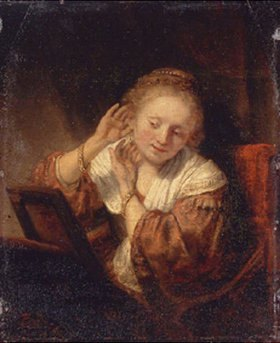 Rembrandt van Rijn: Junge Frau beim Anprobieren von Ohrringen