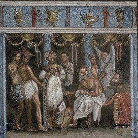 Unbekannt: Mosaik aus dem Haus des Tragödiendichters (Casa del Poeta Tragico): Ein Chorführer gibt Anweisungen an die Schauspieler. Im Vordergrund einige Masken. 3. Jh. v. Chr