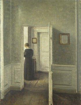 Vilhelm Hammershoi: Frau in einem hellen Innenra