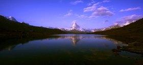 Look of the Stellisee (2537 m) on the Breithorn (4164 m), Matterhorn (4478 m) and the Dent Blanche (4356 m) with Zermatt (1620 m), canton Valais, Switzerland