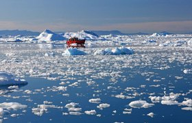 Holiday boat in the drift ice before Ilulissat, Greenland