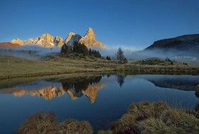 Cima della Vezzana at dawn, Passo Rolle, Parco Naturale Paneveggio Pale di San Martino, Provinz Trento, Dolomiten, Trentino-Südtirol, Trentino, Italien